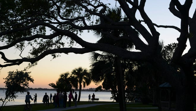 About two dozen people gathered in Douglas Park in Indialantic for a candlelight vigil in solidarity with the students at Marjory Stoneman Douglas High School.