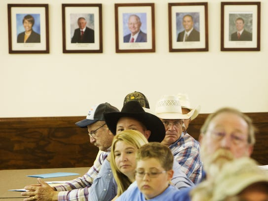 Ranchers and their families gather for a meeting in