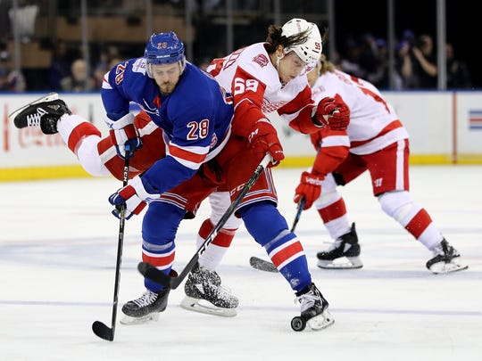 The Rangers' Paul Carey and Red Wings forward Tyler Bertuzzi collide in the first period on Sunday, Feb. 25, 2018, in New York.