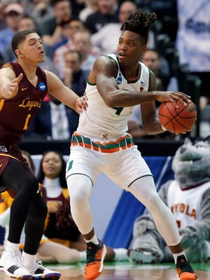 Former Reading High School standout Lonnie Walker IV, right, has announced he's going pro after spending just one year with the Miami Hurricanes. AP FILE PHOTO