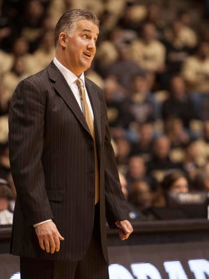 Dec 2, 2014; West Lafayette, IN, USA;  Purdue Boilermakers head coach Matt Painter stands on the sidelines against the North Carolina State Wolfpack at Mackey Arena. The Boilermakers won 66-61. Mandatory Credit: Trevor Ruszkowski-USA TODAY Sports