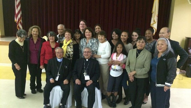 Bishop Dominic Luong and Bishop Randy Calvo center with some of the Chamorro attendees.