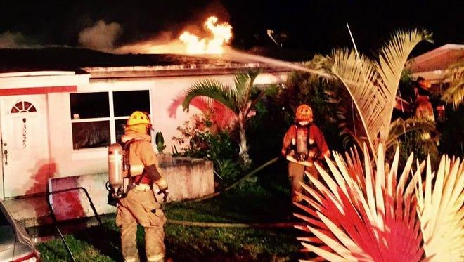 Firefighters battle a house fire on Mura Drive in Fort Pierce on Thursday, July 13, 2017.