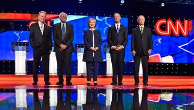 From left: Democratic presidential candidates former Virginia Sen. Jim Webb, Sen. Bernie Sanders of Vermont, Hillary Rodham Clinton, former Maryland Gov. Martin O'Malley, and former Rhode Island Gov. Lincoln Chafee take the stage before the CNN Democratic presidential debate Tuesday, Oct. 13, 2015, in Las Vegas.