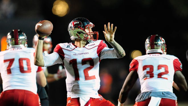 Sep 3, 2015; Nashville, TN, USA; Western Kentucky Hilltoppers quarterback Brandon Doughty (12) looks to throw the ball against the Vanderbilt Commodores during the first half at Vanderbilt Stadium. Mandatory Credit: Joshua Lindsey-USA TODAY Sports