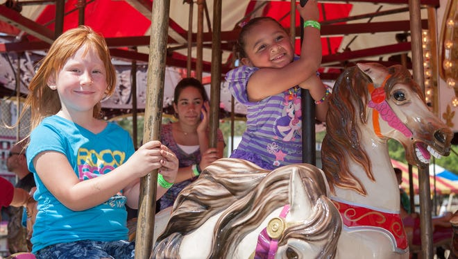 The Lehigh Spring Festival is among this weekend's family-friendly events. In this file photo, from left, is Leah Gilson, then 5, and Kiersten Upshaw, 4.