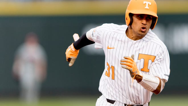 Tennessee's Benito Santiago (31) rounds second base during a game against Alabama earlier this season.
