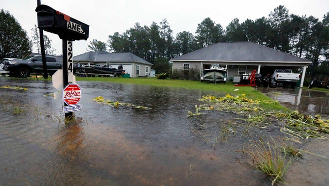 Rising waters threaten homes along North Perkins Ferry Road in Moss Bluff, La., near Lake Charles, La., as a constant rain from Tropical Storm Harvey falls on Aug. 28, 2017.