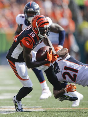 Cincinnati Bengals wide receiver A.J. Green (18) makes a catch as Denver Broncos cornerback Aqib Talib (21) defends in the fourth quarter during the NFL game between Denver Broncos and the Cincinnati Bengals, Sunday, Sept. 25, 2016, at Paul Brown Stadium in Cincinnati. Denver won 29-17.