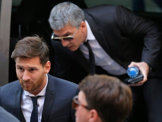 FILE - In this  Thursday, June 2, 2016 file photo, Barcelona soccer player Lionel Messi, left, arrives at a court in Barcelona, Spain. A Barcelona court Wednesday, July 6, 2016 has given Lionel Messi and his father suspended sentences of 21 months in prison for tax fraud. In Spain, sentences of less than two years for first offences are suspended, meaning neither man will go to jail. (AP Photo/Manu Fernandez, File)