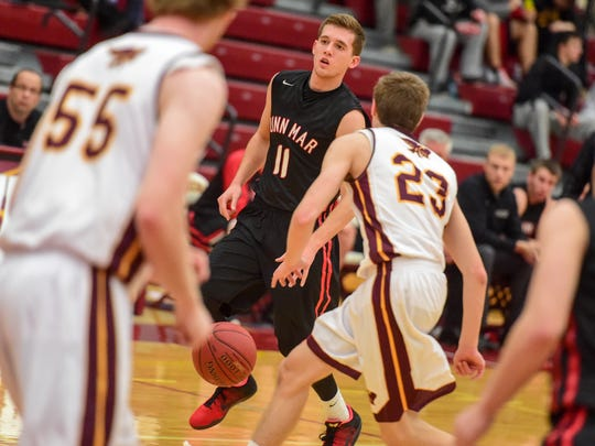 Linn-Mar's Jordan Bohannon (11) brings the ball down