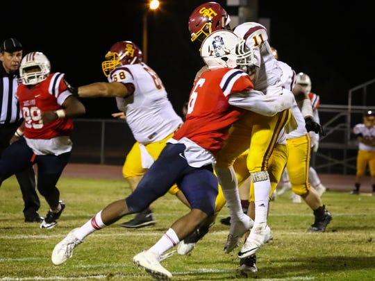 Oakland's Kaleb Oliver, a Mississippi State commitment, drops Science Hill quarterback Jaylan Adams for a loss, but suffered a game-ending shoulder injury as a result.