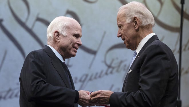Arizona Sen. John McCain (left) receives the Liberty Medal from former Vice President Joe Biden Oct. 16, 2017. Cindy McCain suggested Monday that former Biden, a longtime family friend, visited Sunday with her ailing husband.
