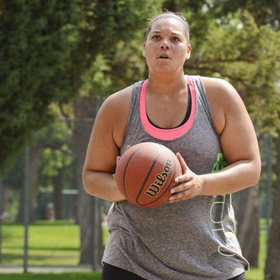 Extreme Weight Loss coach Chris Powell, left, trains with Kelli Poles, a single, 26-year-old bank teller living in Kansas City, Missouri, who left basketball behind after playing for the University of Vermont.