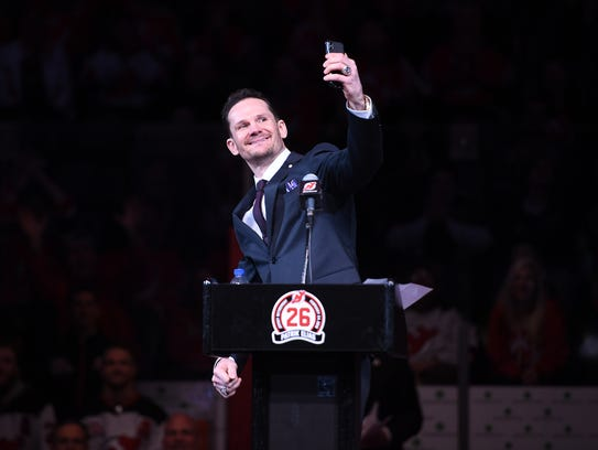 Patrik Elias takes a selfie during his jersey retirement