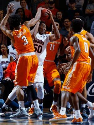 Auburn's Austin Wiley is defended by Tennessee guard Robert Hubbs III (3) in the first half of their NCAA college basketball game on Tuesday, Jan. 31, 2017 in Auburn, Ala. (Todd J. Van Emst/Opelika-Auburn News via AP)
