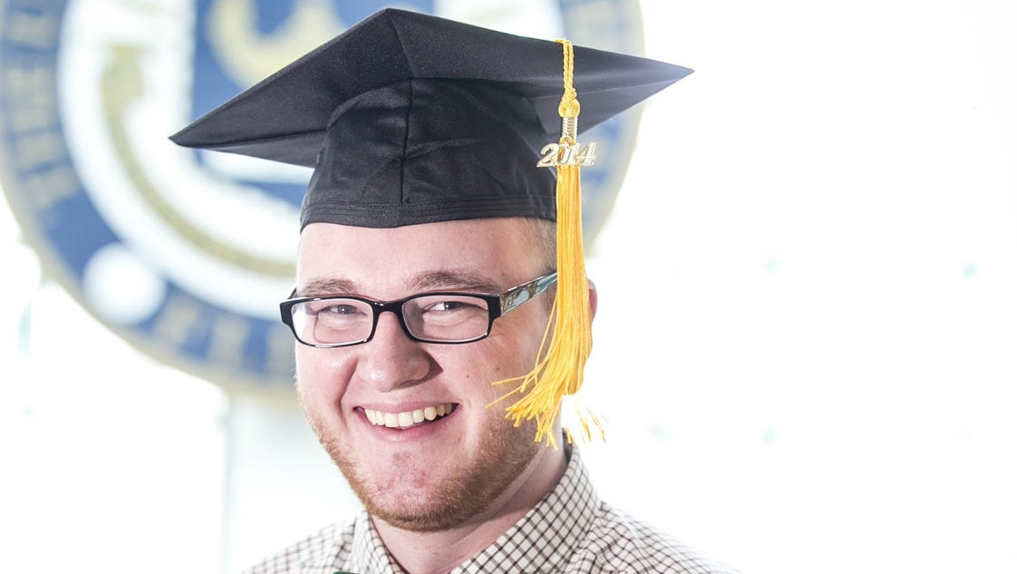 Student selling ad space on graduation cap to pay loans