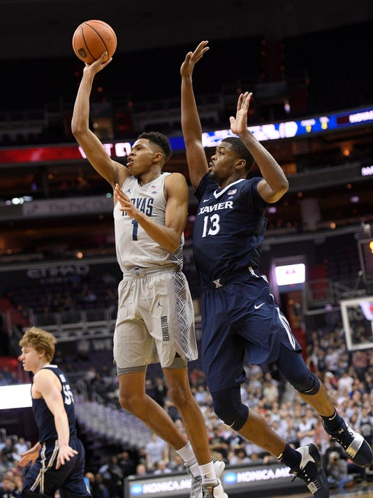 Georgetown forward Jamorko Pickett (1) shoots against Xavier forward Naji Marshall (13) during the second half of an NCAA college basketball game, Wednesday, Feb. 21, 2018, in Washington. Xavier won 89-77. (AP Photo/Nick Wass)