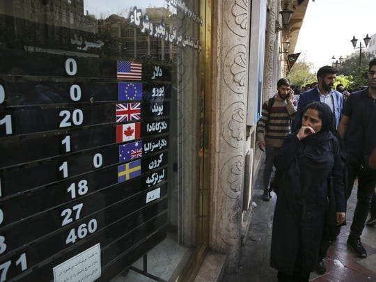 In this Oct. 2, 2018, file photo, an exchange shop displays rates for various currencies, in downtown Tehran, Iran. The Trump administration is closely eyeing efforts in Europe to set up an alternative money payment channel to ease doing business with Iran and avoid running afoul of sanctions the U.S. has levied on the Islamic republic.