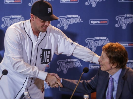 Jordan Zimmermann shakes hands with Tigers owner Mike Ilitch during Zimmermann's introductory news conference on Monday at Comerica Park.