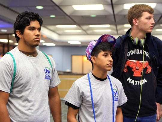 Jose Galaviz, 18 (from left), Daniel Collin, 19, and James Harper, 18, tour Texas A&M University-Corpus Christi as part of the Preparation for Adult Living program for youths who have received services from the Texas Department of Family and Protective Services on Wednesday, July 12, 2017.