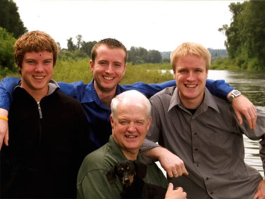 Peter Courtney with his three sons, Adam, from left,