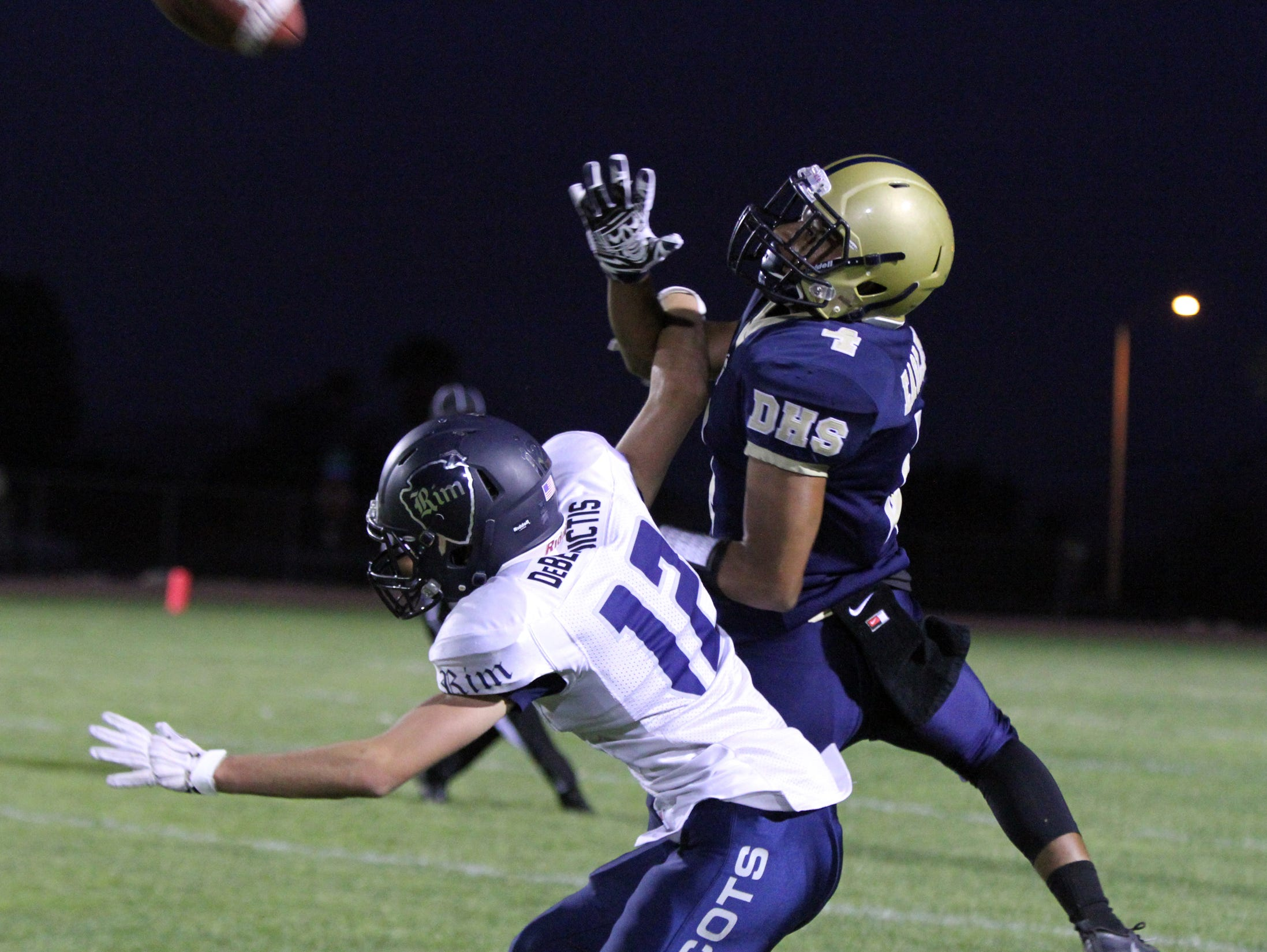 Rim of the World's Taylor Debenedictis, left, interferes on a pass intended for Desert Hot Springs' Alber Montes-Reyes during the first half of the game in Desert Hot Springs on Friday, September 16, 2016.
