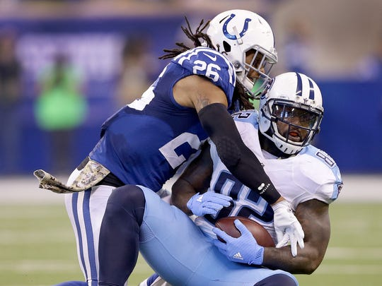 Indianapolis Colts free safety Clayton Geathers (26) hits Tennessee Titans tight end Delanie Walker (82) in the first half of  their NFL football game Sunday, November 20, 206, afternoon at Lucas Oil Stadium
