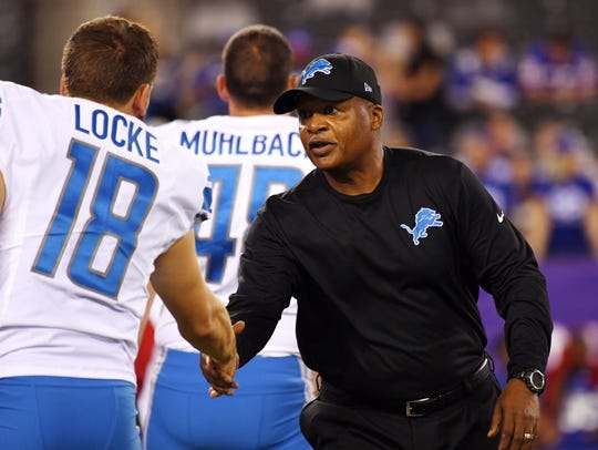 Lions coach Jim Caldwell shakes the hand of punter