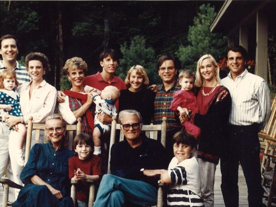 The Rev. Billy Graham, seated with his wife, Ruth, and their children and grandchildren.