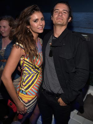 Nina Dobrev and Orlando Bloom attend the Playboy and A&E ?Bates Motel? Event During Comic-Con Weekend, on July 25, 2014 in San Diego, California.