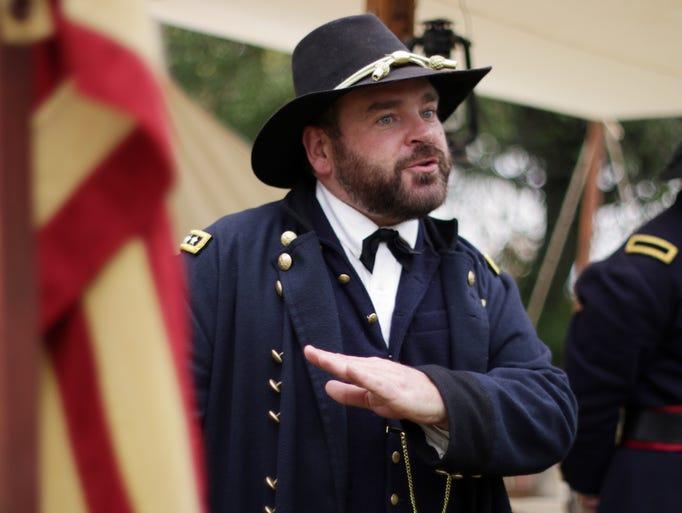A Civil War re-enactor, portraying Ulysses Grant ,explains