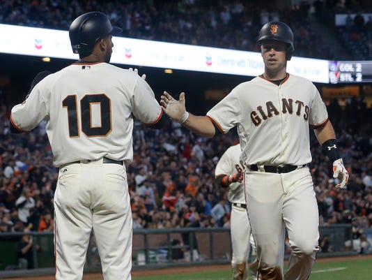 San Francisco Giants' Eduardo Nunez, left, and Buster Posey celebrate after both scored against the Pittsburgh Pirates during the third inning of a baseball game in San Francisco, Tuesday, July 25, 2017. (AP Photo/Jeff Chiu)