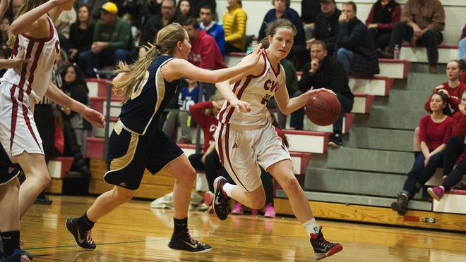 Champlain Valley's Laurel Jaunich (11) drives to the hoop past Essex's Lizzie Goodrich (20) during the girls basketball game on Tuesday night in Hinesburg. CVU won 63-28.