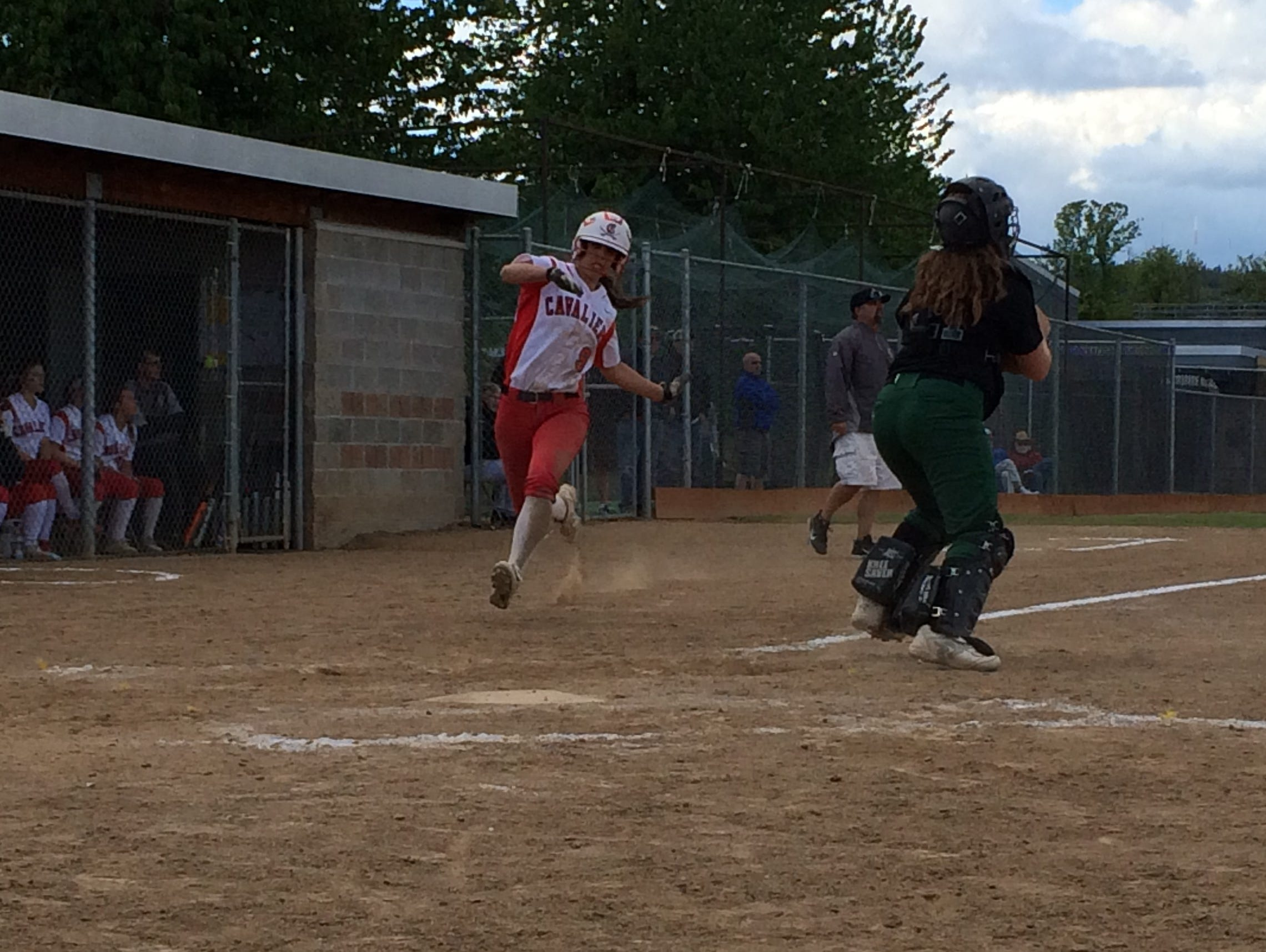 Clackamas' McKenzie Giancola scores in the fifth inning against Reynolds.
