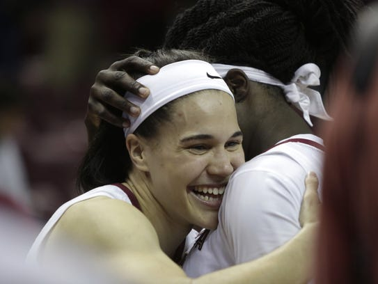 Florida State's Brittany Brown hugs teammate Shakayla