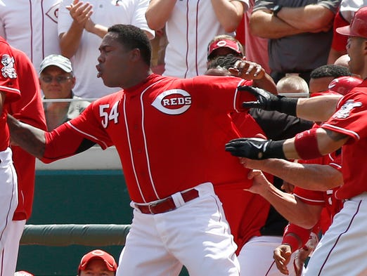 Cincinnati Reds relief pitcher Aroldis Chapman (54) is restrained by teammates during a bench clearing scuffle with the Chicago Cubs in the tenth inning.
