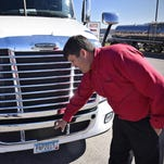General Manager Jon Pearson drives a demonstration truck Oct. 1 near Freightliner of St. Cloud. The truck is used to give drivers the chance to experience the Detroit Assurance Safety System.