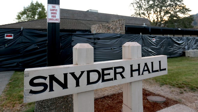 Snyder Hall surrounded by black plastic at Umpqua Community College in Roseburg.