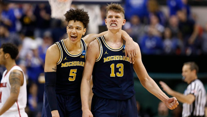 Michigan forwards Moritz Wagner (13) and D.J. Wilson celebrate March 19, 2017, in Indianapolis.