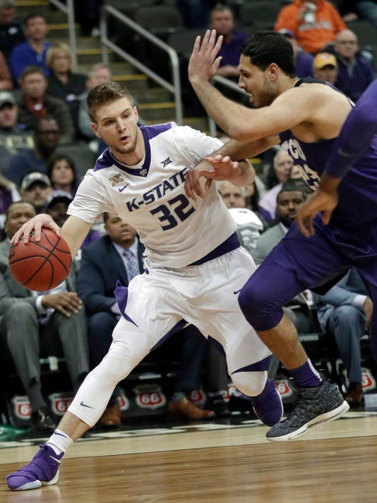 Kansas State forward Dean Wade (32) looks for room around TCU forward Ahmed Hamdy-Mohamed (23) during the first half of an NCAA college basketball game in quarterfinals of the Big 12 men's tournament in Kansas City, Mo., Thursday, March 8, 2018. (AP Photo/Orlin Wagner)