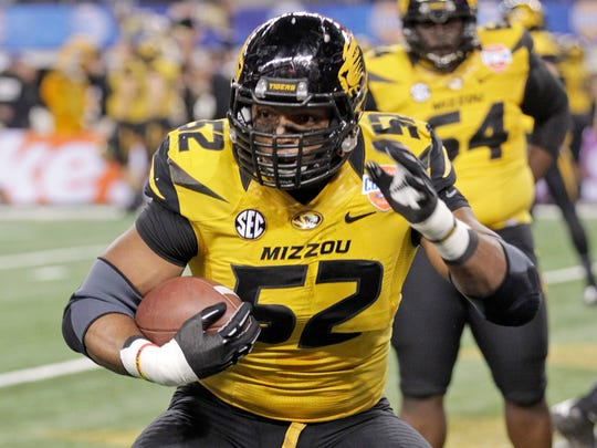 Missouri defensive lineman Michael Sam (52) warms up before the Cotton Bowl.