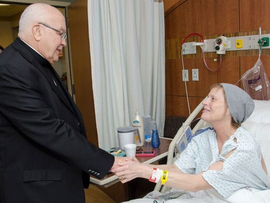 The Most Rev. Paul G. Bootkoski, bishop of Metuchen, blesses patient Kathleen Kilgore of Pittstown during World Day of the Sick on Feb. 10 at Saint Peter's University Hospital in New Brunswick. World Day of the Sick includes the Anointing of the Sick, one of the Catholic Church's seven sacraments. The anointing is reserved for people whose health is seriously impaired or stressed by aging.