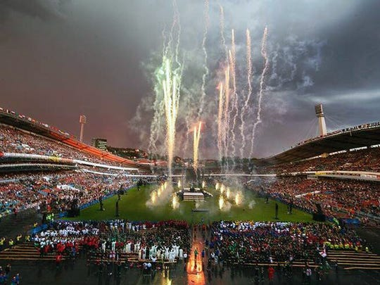 Fireworks go off to signal the end of the opening ceremonies