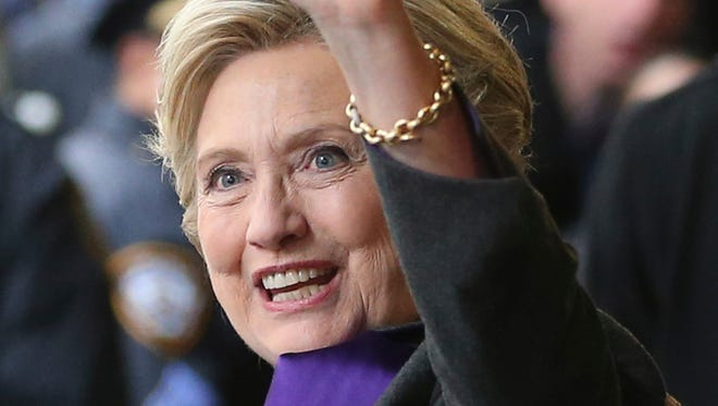 "Hillary Clinton waves as she leaves a New York hotel after speaking to her staff and supporters Wednesday, Nov. 9, 2016. Earlier in the day she conceded the race to Republican president-elect Donald Trump. Clinton says America ""is more deeply divided than we thought,"" but she is urging her supporters to accept the outcome of the presidential election."