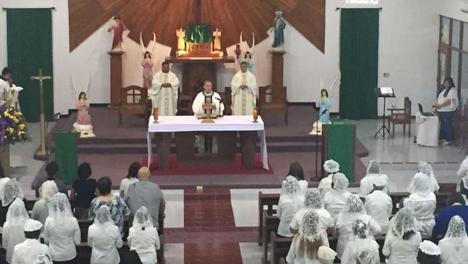 Archbishop Michael J. Byrnes celebrates Mass at the Immaculate Heart of Mary Catholic Church in Toto.