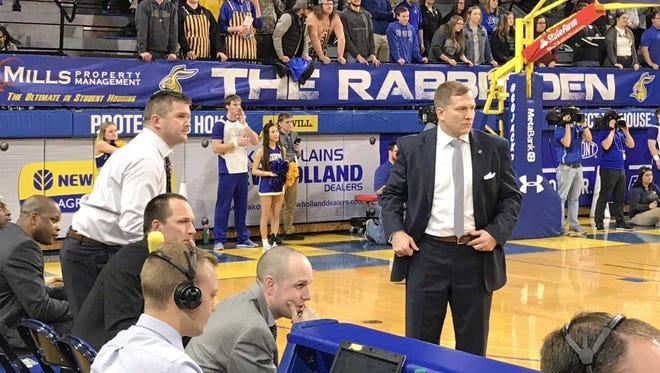 SDSU coaches Rob Klinkefus (left) and TJ Otzelberger, watch the action in Tuesday's 80-60 win over Omaha
