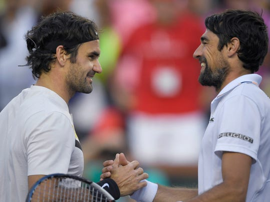 Roger Federer, of Switzerland, left, shakes hands with Jeremy Chardy, of France, after Federer's win at the BNP Paribas Open tennis tournament Wednesday, March 14, 2018, in Indian Wells, Calif. (AP Photo/Mark J. Terrill)