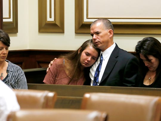 Kevin Murphy hugs his daughter before he was sentenced to two years in prison Tuesday, July 11, 2017. Murphy, 51, a former Taylor High School teacher admitted having sex with a student. He resigned his teaching and football coach positions in November 2016 after being employed by the district for about 20 years.  According to court documents, Murphy is accused of having sex with the female student six times between Oct. 9 and Nov. 2. He pleaded guilty in May.