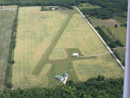 An aerial view by Crispy Cedars Airfield by proprietor